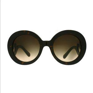Prada Tortoise Round Womens Sunglasses